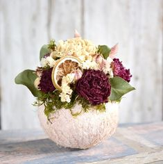 Dried flowers bouquet in a coconut shell Dried Flower Bouquet, Dried Flowers, Coconut Shell, Table Decorations, Home Decor, Flower Preservation, Decoration Home, Room Decor, Home Interior Design