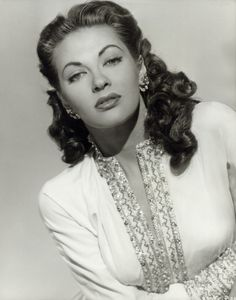 """Yvonne De Carlo (1922–2007) was a Canadian actress, singer, & dancer whose career in film, television, & theater spanned six decades. Described as """"the most beautiful girl in the world"""", she obtained her breakthrough role in Salome, Where She Danced (1945). Her film career reached its peak when director Cecil B. DeMille cast her as Sephora, the wife of Moses, her most prominent role, in his biblical epic The Ten Commandments (1956). She played Lily Munster in the CBS sitcom The Munsters"""