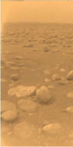 Europe's Huygens Probe Landed in Titan Mud >>>> The Huygens probe took this photo from the surface of Titan. The image has been colored and processed to give a good indication of the actual orangeish color of the surface.