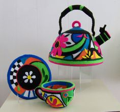This is felt...... But I think I am going to buy a whistling kettle and paint it like this.... How cute !!!!