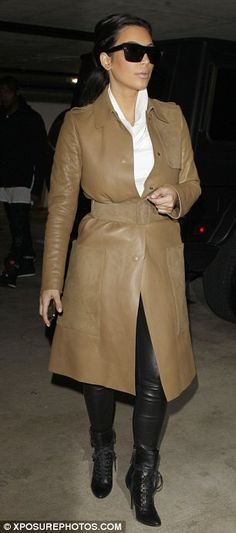 Rawhide: The 32-year-old reality star wore a long beige coat and a pair of tight trousers made in her favourite material