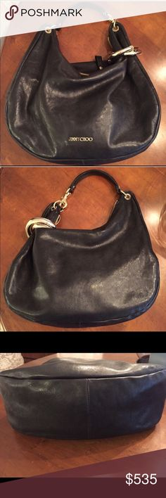 Jimmy Choo Large Black Leather Solar Hobo Purse! Jimmy Choo Large Black Leather Solar Hobo Purse! Very Gently used and bag is in excellent condition! 100% authentic and comes with original dust bag to store in. Removable gold thick bangles. Bag measures approximately 17 inches wide and and 12 inches long. Smoke free and pet free home. Absolutely gorgeous bag! Retails for $1,495.00. Jimmy Choo Bags Hobos