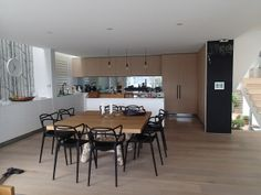 My friend Derryn's new kitchen. Engineered oak floors, smokey mirror splashback, table with natural wood legs