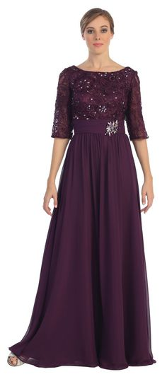 Get out of your every day clothes and into this elegant, floor length, half sleeve mother of the bride dress. Formal yet unique with an all lace bodice, gathering at the waist complete with a broach,