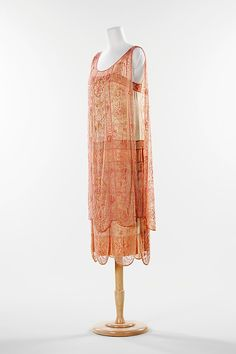 ca. 1926  This evening dress is an excellent example of the period. The 1920s was the era of the flapper and her nights were sp...