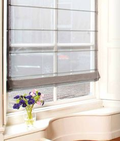 A beautiful sheer roman shade from Vadain. Creating privacy while keeping the light.