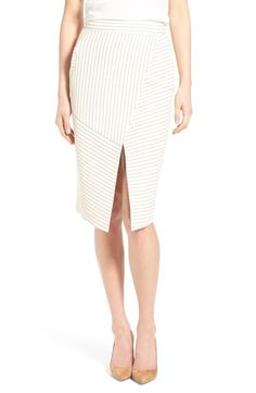 Adding a modern and sophisticated twist to the classic pencil skirt with angled stripes and a slit.