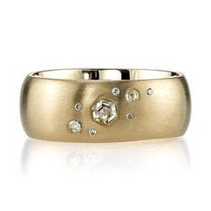 0.13ctw old European and Rose cut diamonds set in a handcrafted 18K yellow gold cigar band.Please inquire for additional sizesandcustomization.