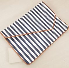 Adorne Pointed Flapover Large Striped Clutch – Navy/Tan