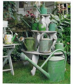 This would make great porch decor! Vintage Watering Cans | Nenaghgal
