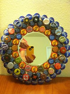 Bottle cap mirror that I made (: so happy with how it came out. #beer #bottlecaps #crafts #art #fun