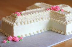 cross cake modified wilton cross pan cake i added an extra layer . Mini Cakes, Cupcake Cakes, Cupcakes, Wilton Cakes, Baptism Cross Cake, First Holy Communion Cake, Cross Cakes, Cake Icing, Occasion Cakes