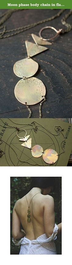 Moon phase body chain in flame painted brass. Taking inspiration from the lunar cycle this body chain uses geometric stylised designs to represent the new, crescent, half, gibbous and full moons. Each moon uses hand cut and hammered 0.5 mm sheet brass (the new moon is fabricated from 18 gauge brass wire) that has been cleansed in fire. The resulting rainbow patina has then been sealed with microcrystalline wax to hinder further oxidation. The default harness size would fit a UK 8-14 (US…