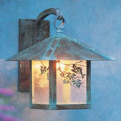 Arroyo Craftsman Evergreen Outdoor Wall Lantern. Shown with Sycamore filigree clear seedy glass and verdigris patina finish. This collection expresses a blend of Swiss Chalet, English Tudor, and California Mission styles.