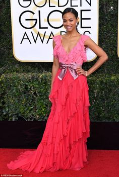 Got frills! Zoe Saldana kept her new inking under wrap and ruffles as she walked the red carpet at the 74th Golden Globe Awards on Sunday