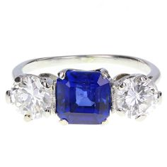Square Cut Burma Sapphire Diamond Platinum Three Stone Ring | From a unique collection of vintage three-stone rings at https://www.1stdibs.com/jewelry/rings/three-stone-rings/