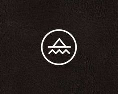 Logo for a production company called Pacific Coast Highway, where the water and mountains meet.