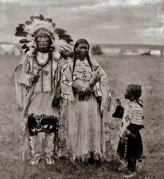 L-R: Wasu Maza (aka Iron Hail, aka Dewey Beard) (Mniconjou) with his 2nd wife, Alice Lone Bear-Beard (Oglala) and their granddaughter, Celene Marie Not Help Him (Oglala/Mniconjou) - 1920 {Note: Iron Hail's first wife was named Wears Eagle. She and a baby son named Wet Feet, were killed at the massacre at Wounded Knee Creek on 29 December 1890. Iron Hail and his older son Thomas, survived the Wounded Knee massacre.