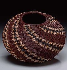 Christine Adcock |  Coiled basket of dyed and natural torrey pine needles.