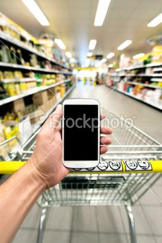Shopping at the supermarked with smart phone Royalty Free Stock Photo
