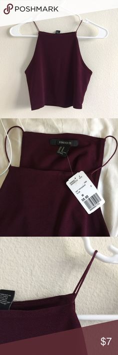 Wine purple halter crop top Maroon burgundy wine red square halter neckline crop top. Thin straps. Stretchy. Medium stretch knit. Lined. Size medium from forever 21. New with tags.    🚫Trades 🚫Off posh transactions or 🅿️🅿️ 🚫negotiating in comments  🚷lowballs blocked ✅REASONABLE offers ✅Bundle for 30% off for 3 items or more. Forever 21 Tops Crop Tops