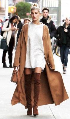 Hailey Baldwin in a long sweatshirt with thigh high boots
