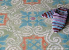 Moroccan-inspired SkimStone and Modello® stencil treatment with custom colors and OrnAll 122.