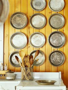 Vintage pie pans used to decorate a #kitchen wall. More ideas for adding vintage style: http://www.bhg.com/decorating/decorating-style/flea-market/flea-market-chic-home-accents/?socsrc=bhgpin042212pietins