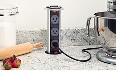 Amazing popout outlet in kitchen island. Would love to see this on a vanity in a bathroom as well.