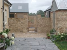 New reconstituted stone and Cotswold gravel
