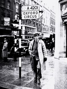 CBS wartime correspondent Edward R. Murrow pauses on London's Oxford Circus, circa 1940.
