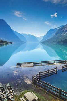 Lake Lovatnet provides beautiful scenery in Lodal valley (Norway) on the edge of the great Jostedalsbreen glacier. When the glacial water reaches the lake, it looks green, especially when the sun shines.