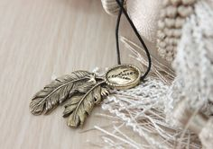 #Bronze #raven (track and feathers) pendant 5 sm (1.9 inch) in height, bronze. Comes with the waxed cord.  All #jewelry in my shop: https://www.etsy.com/ru/shop/DemiurgusDream... #pendant #necklace #fantasy #unisex #totem #bronze #bird #feather