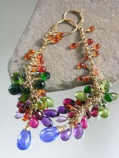 ...........ridiculously juicy!!    I took tassels out of my line several years ago because just too many of them on the net. But theyre baaaaccckkkkk!!!! And better than ever!!    Slender 14k gold filled rolo chains are lavishly bestowed with color drenched gemstones of orange sapphires, chrome diopside, peridot, vesuvianite, blue-green sapphire, deep green apatite, rhodolite garnet, pink tourmaline, ruby, red garnet and amethyst...........and, drum roll please.......    .....tipped with…
