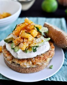 Shrimp Burgers with Chipotle and Coconut Peach Salsa - Yes, coconut-peach salsa does exist. And it's delicious. Pair it with a savory shrimp burger and a chipotle cream sauce for a zesty and juicy sandwich that's perfect for lunch or dinner. Seafood Dishes, Fish And Seafood, Shrimp Recipes, Fish Recipes, Salmon Recipes, Pasta Recipes, Great Burger Recipes, Shrimp Burger, Tacos