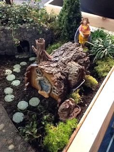 Fallen log fairy house. Maybe an oatmeal container on its side, covered in pine cone shingles...