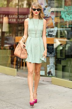 lTaylor looked the epitome of NYC chic leaving a restaurant in a mint green dress, bright red lips, and fuchsia heels.