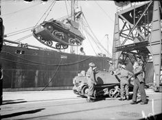 A Light Tank Mk VI and Bren gun carrier being unloaded from a ship at Southampton during the return of the second British Expeditionary Force from France, 19 June 1940.