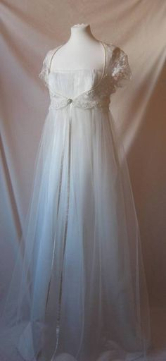 I kind of love this, and I read an article in Mary Jane's Farm about a lady who recycles wedding dresses by dying them and/or adding details.