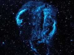 Cygnus Loop Nebula, taken by NASA's Galaxy Evolution Explorer. The nebula lies about 1,500 light-years away, and is a supernova remnant, left over from a massive stellar explosion that occurred 5,000-8,000 years ago.
