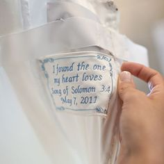a favorite verse of Scripture sewn into the wedding gown
