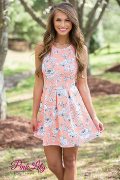 You'll definitely have some delightful days in this gorgeous floral dress! Featuring a neon coral fabric paired with a white and black floral print, this sweet dress is perfect for your favorite summer occasions!