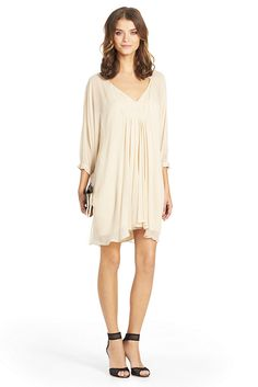 Breezy and simple, the Fluerette is a must-have silhouette for any season. Its sheer sleeves pair perfectly with feminine heels for a laid back elegance. Open v-neck with cinching under bust and pleats. 3/4 dolman sleeves. Buttons at cuffs. In silk chiffon with lined bodice. Fit runs large.
