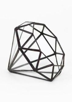 Shine bright like a diamond! This piece can work as a terrarium, a vessel for holding a collection of objects, or just as a stand-alone knick-knack.