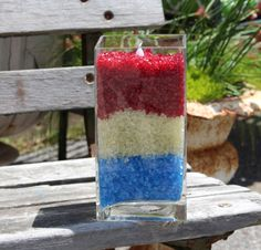 Make your own candle by layering colored rocks in your fav vase and add a t-life candle on top. Here we're celebrating America! Available at S&J Gift Outlet