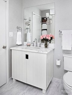 Find out how to create a sparkling white bathroom using white and similar neutral hues. #whitebathrooms