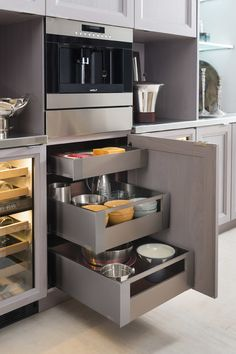 Pull out drawers in kitchen cabinets make accessing a cabinet's contents much easier.  Not to mention, appliances such as this coffee maker, at arm's level aid in functionality. | #DesignLUX & Barrier Free Luxury Interior Design