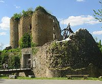 Castle Francimont ruins near Liege in the Belgian Ardennes forest with Trebuchet