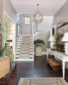We can't get over @ashleyfgilbreath's dreamy foyer for the @southernlivingmag Idea House! #slideahouse