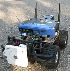 A remote control car that can be driven over the internet or with a laptop wirelessly from up to 500m away. It has a live-feed network camera so that it can be driven without line of sight and a horn so that you can honk at people.